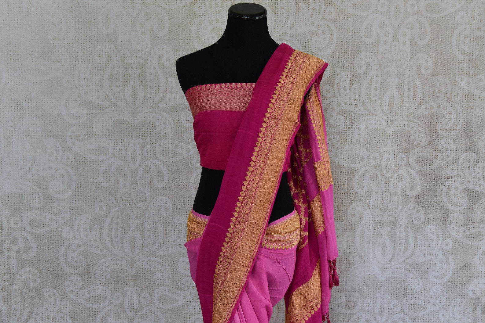 90D357 Traditional pink saree with a classic golden border. The Georgette Banarasi saree, with an ombre effect is ideal for Indian wedding functions and can be bought online at our Indian wear store - Pure Elegance.