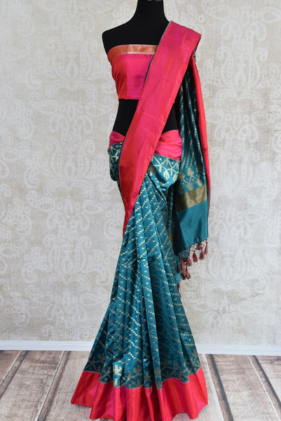 90D359 Blue-green sari with red border, ideal for weddings and festive occasions. The silk saree with satin border is available at Pure Elegance - our ethnic fashion shop online and in Edison, USA.