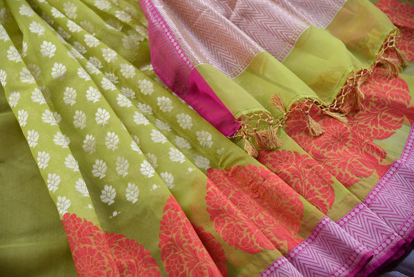 90D360 Vibrant green sari with pops orange and dull golden and a pink border. The kora Banarasi saree, available online at our store in USA, makes for a wonderful Indian outfit for weddings & festive occasions.