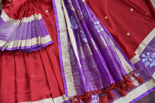90D361 Red silk saree topped with a purple tissue border having traditional motifs and a golden trim. The ethnic Indian saree, perfect for festive occasions, can be bought online in USA at Pure Elegance.