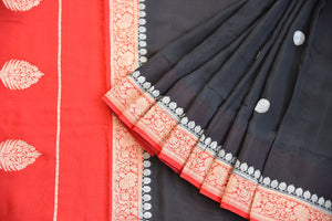 90D362 Black and red sari with a traditional golden border. This party wear saree, a georgette Banarasi Indian outfit is available at our online Indian fashion store - Pure Elegance and will be a fantastic addition to your wardrobe!