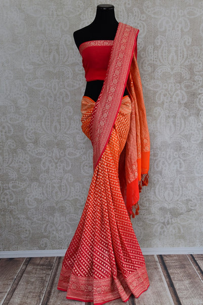 90D365 Shaded and two toned orange & pink traditional saree with golden pattern and designs, available at our ethnic clothing store online in USA. The georgette banarasi saree makes for an ideal Indian wedding outfit and is sure to have you looking beautiful!