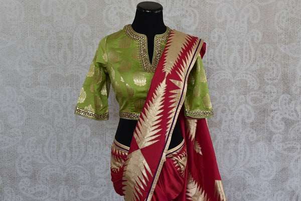 90D368 Traditional red silk saree with golden applique work & green designer blouse. perfect for Indian weddings and festive occasions, this saree is available at our ethnic wear store online in USA.