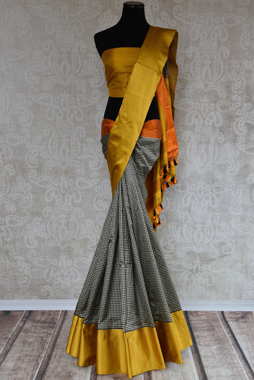 Buy this Indian traditional satin silk banarasi saree from Pure Elegance online or from our store in USA. Ideal for any baby shower, puja, sangeet, wedding and reception. Front View.