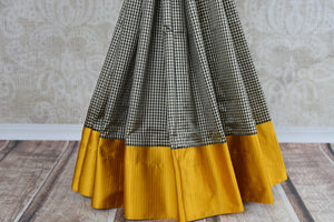 Buy this Indian traditional satin silk banarasi saree from Pure Elegance online or from our store in USA. Ideal for any baby shower, puja, sangeet, wedding and reception. Gray and Yellow.