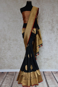 Shop this traditional Indian black banarasi silk zari saree online or from our Pure Elegance store in USA. Right for any puja, baby shower, sangeet, reception or wedding. Front View.