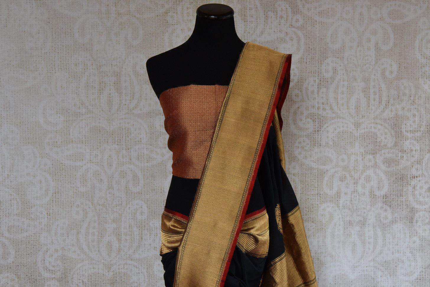 Shop this traditional Indian black banarasi silk zari saree online or from our Pure Elegance store in USA. Right for any puja, baby shower, sangeet, reception or wedding.  Top View.