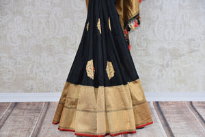 Shop this traditional Indian black banarasi silk zari saree online or from our Pure Elegance store in USA. Right for any puja, baby shower, sangeet, reception or wedding. Close up.