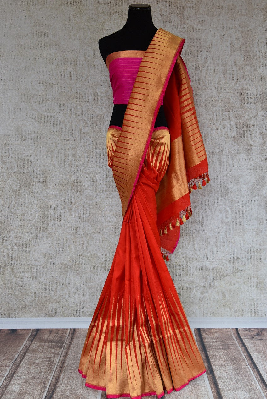 Shop this traditional Indian banarasi silk saree with zari border from Pure Elegance online or from our store in USA. Perfect for any wedding, reception or sangeet. Front View.