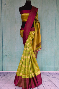 90D378 Silk Banarasi floral saree available at our ethnic Indian clothing store in USA. The green saree with a contrasting maroon border is a great pick for Indian weddings & receptions.