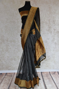 Shop this traditional Indian black and gold kora banarasi saree from Pure Elegance online or from our store in USA. Perfect for any wedding, reception, sangeet or engagement. Front View.