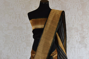 Shop this traditional Indian black and gold kora banarasi saree from Pure Elegance online or from our store in USA. Perfect for any wedding, reception, sangeet or engagement. Top View.