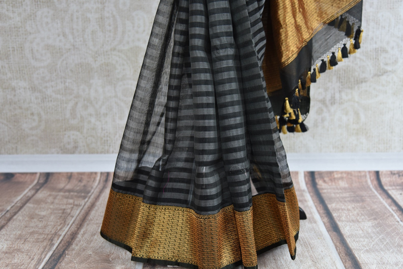 Shop this traditional Indian black and gold kora banarasi saree from Pure Elegance online or from our store in USA. Perfect for any wedding, reception, sangeet or engagement. Gold Border.