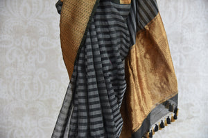 Shop this traditional Indian black and gold kora banarasi saree from Pure Elegance online or from our store in USA. Perfect for any wedding, reception, sangeet or engagement. Golden Pallu.