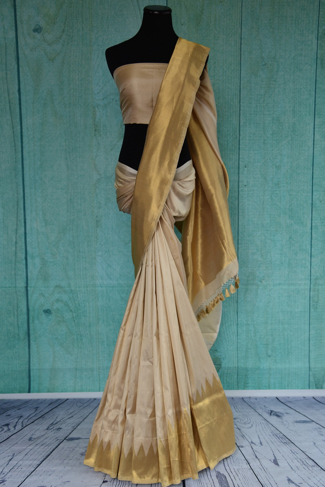 90D385 Off white and golden Banarasi silk saree available at our store Pure Elegance. This party wear saree will be a graceful addition to your Indian ethnic wear wardrobe.
