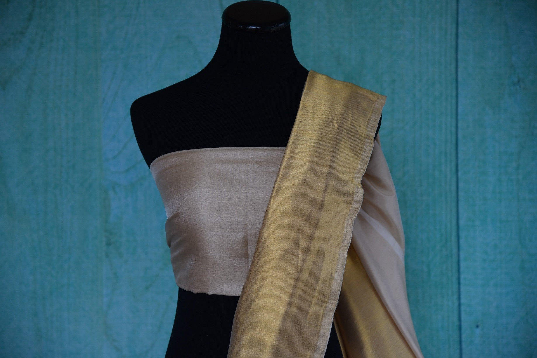 90D385 Off white and golden Banarasi silk saree available at our store Pure Elegance. This party wear saree will be an elegant addition to your Indian ethnic wear wardrobe.