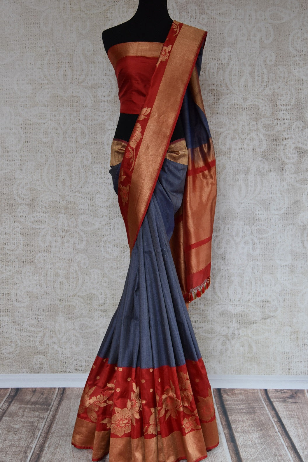 Shop this Indian traditional grey and golden tussar banarasi saree from Pure Elegance online or from our store in USA. Perfect for any reception, wedding or sangeet. Front View.