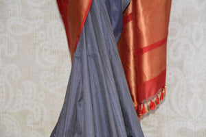 Shop this Indian traditional grey and golden tussar banarasi saree from Pure Elegance online or from our store in USA. Perfect for any reception, wedding or sangeet. Close up.