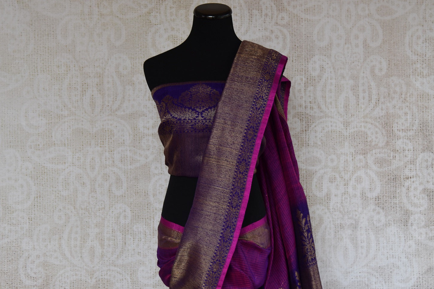 Shop this traditional Indian silver and purple muga banarasi saree from Pure Elegance online or from our store in USA. Perfect for any wedding, reception or sangeet. Top View.