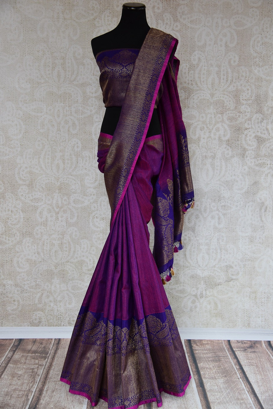 Shop this traditional Indian silver and purple muga banarasi saree from Pure Elegance online or from our store in USA. Perfect for any wedding, reception or sangeet.  Front View.