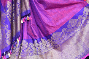 Shop this traditional Indian silver and purple muga banarasi saree from Pure Elegance online or from our store in USA. Perfect for any wedding, reception or sangeet. silhouette.