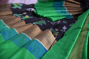 Buy this ethnic Indian black and green ikkat silk saree from Pure Elegance online or from our store in USA. Perfect for any wedding, reception or sangeet party. Green and Black.