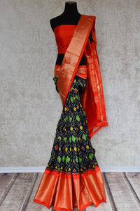 Shop this ethnic Indian orange and black ikkat silk saree online or from our Pure Elegance store in USA. Perfect for any wedding, reception, sangeet party or puja. Front View.