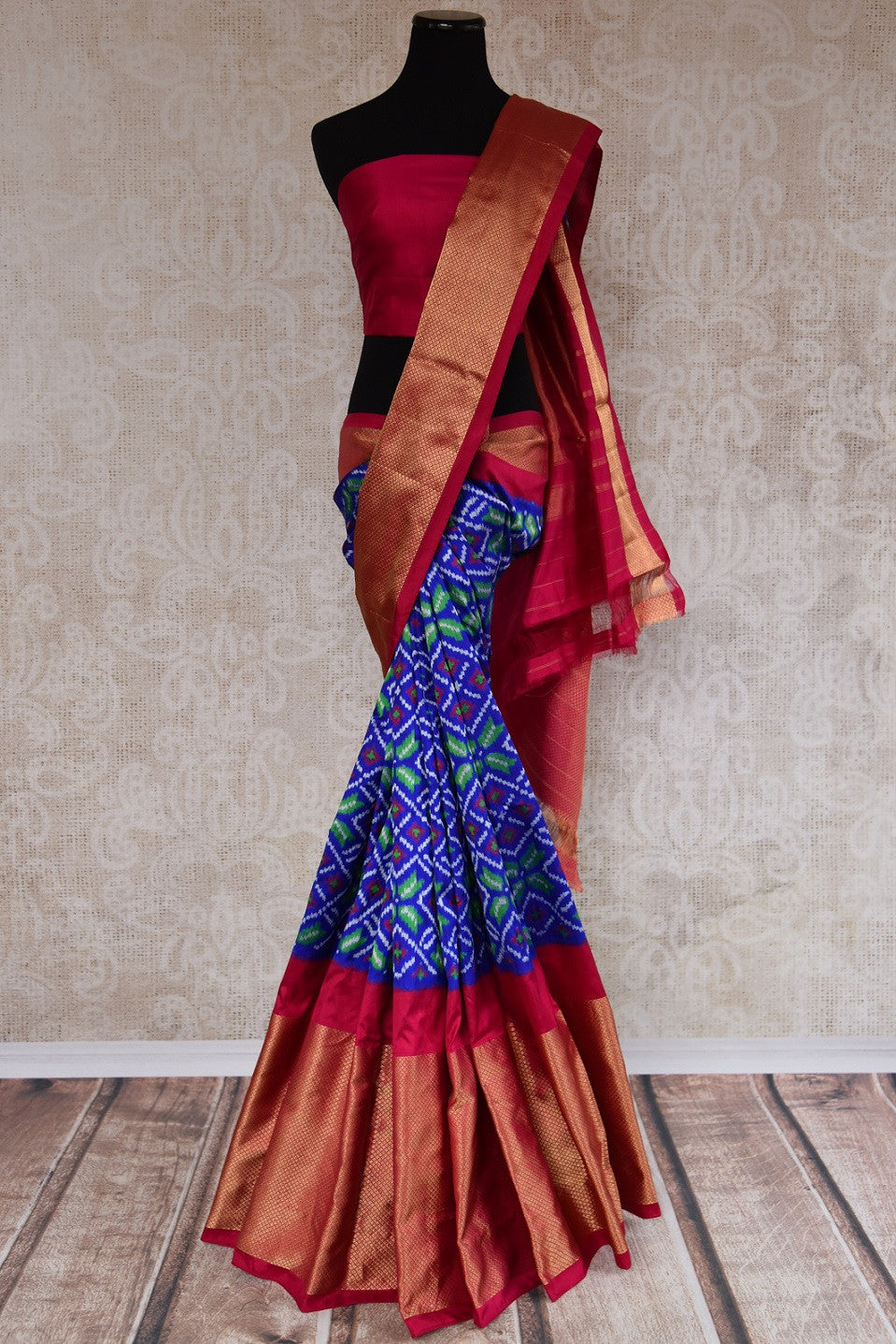 Shop this traditional Indian blue and pink silk ikkat saree online or from our store in USA. Perfect for any puja,  wedding, reception, sangeet or engagement party. Front View.