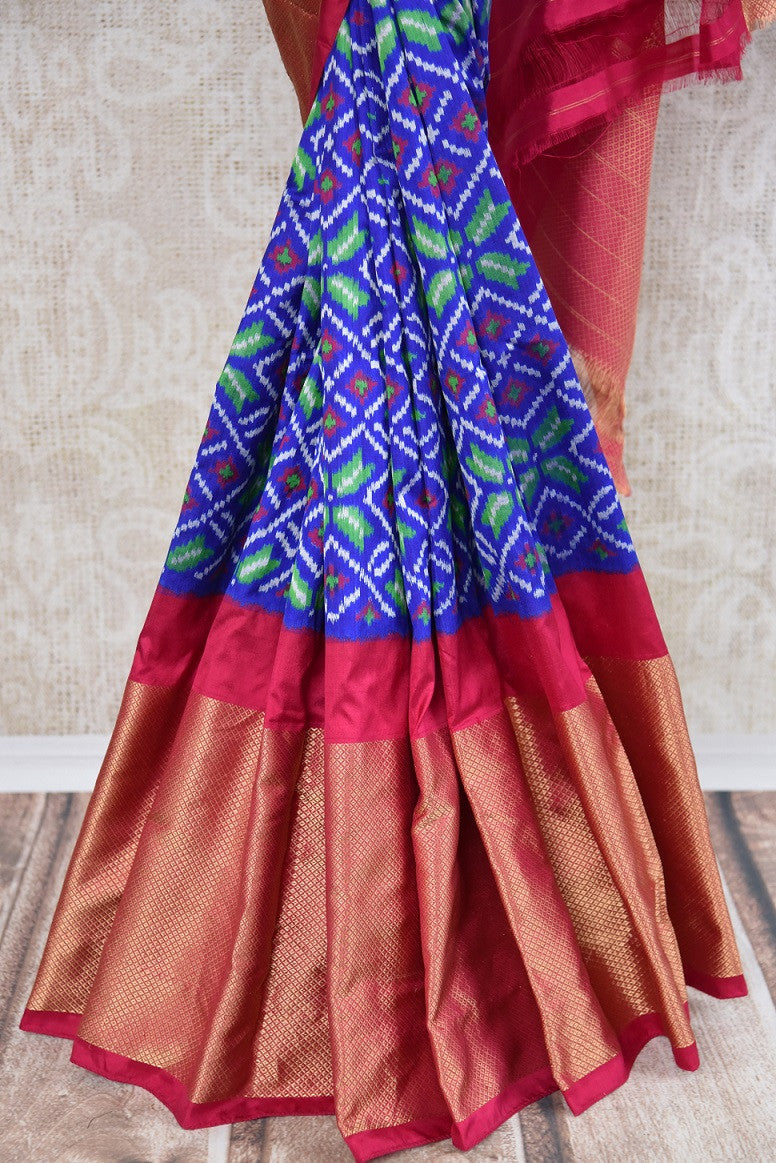Shop this traditional Indian blue and pink silk ikkat saree online or from our store in USA. Perfect for any puja,  wedding, reception, sangeet or engagement party. Blue and Red.