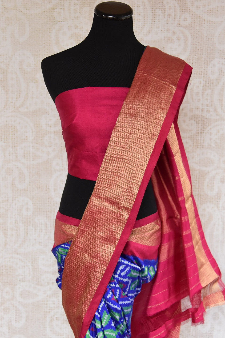 Shop this traditional Indian blue and pink silk ikkat saree online or from our store in USA. Perfect for any puja,  wedding, reception, sangeet or engagement party. Top View.