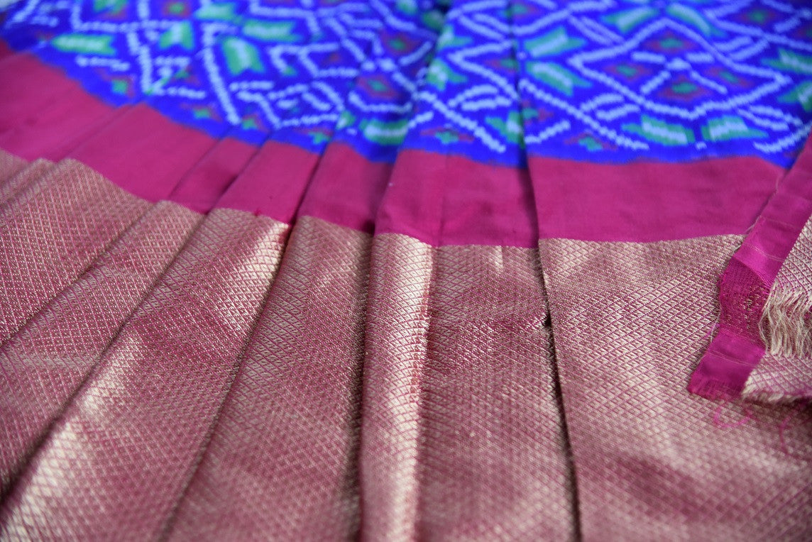 Shop this traditional Indian blue and pink silk ikkat saree online or from our store in USA. Perfect for any puja,  wedding, reception, sangeet or engagement party.  Golden Print.