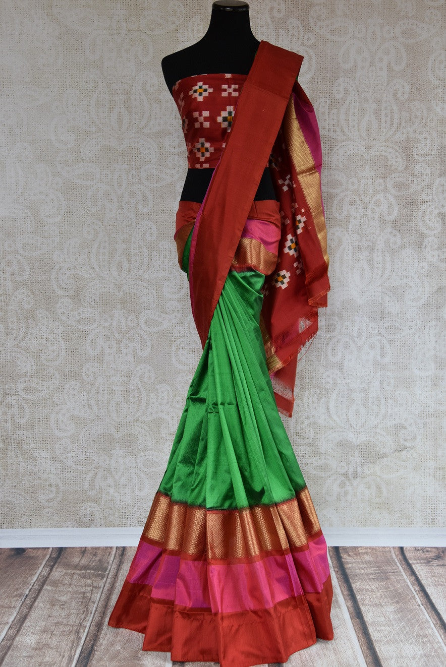 Buy this Indian traditional red and green silk saree online from our store in USA or online. Perfect for any puja, baby shower, wedding, reception or sangeet party. Front View.
