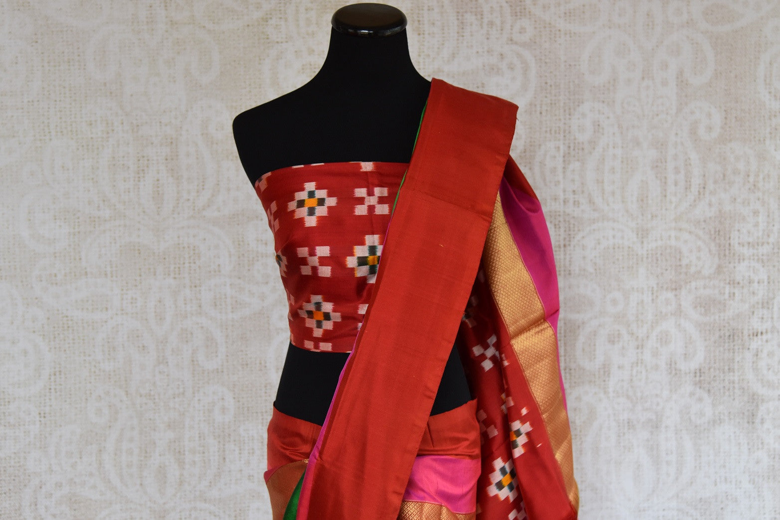Buy this Indian traditional red and green silk saree online from our store in USA or online. Perfect for any puja, baby shower, wedding, reception or sangeet party. Top View.