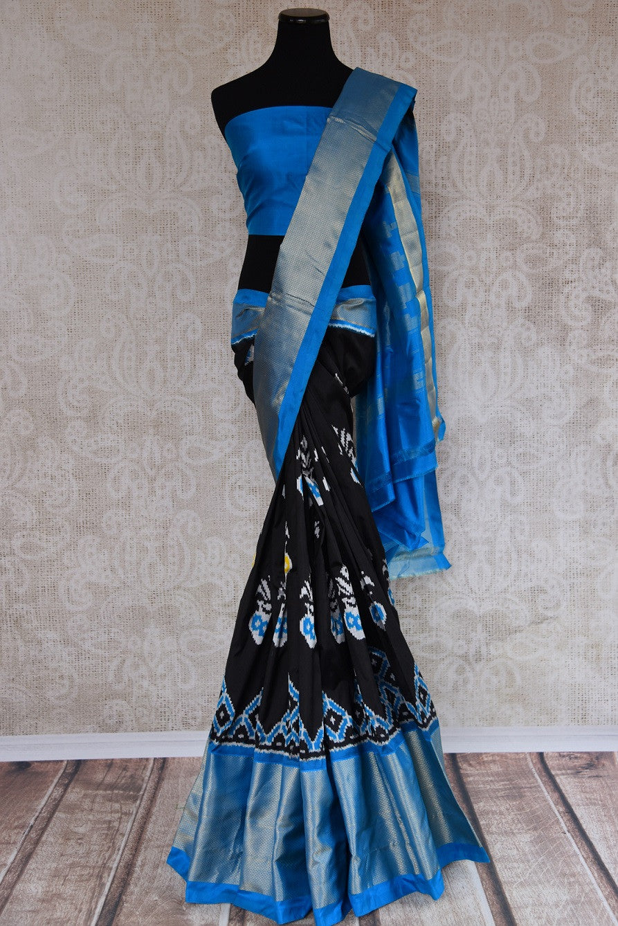 Shop this Indian traditional blue and black silk ikkat saree from Pure Elegance online or from our store in USA. Perfect for any wedding, reception or sangeet. Front View.