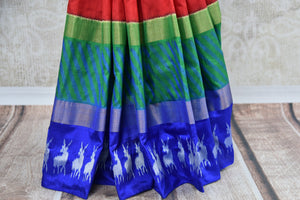 Shop this Indian traditional ikkat silk saree from Pure Elegance online or from our store in USA. Perfect for any wedding, reception, sangeet or reception party. Silver Border.