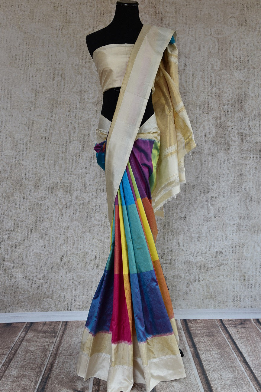 Shop this ethnic Indian off white and multicolor saree from Pure Elegance online or from our store in Edison near NJ. Perfect for any sangeet, reception or engagement party.  Front View.
