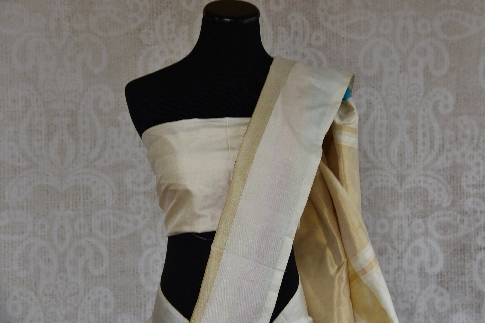 Shop this ethnic Indian off white and multicolor saree from Pure Elegance online or from our store in Edison near NJ. Perfect for any sangeet, reception or engagement party. Top View.