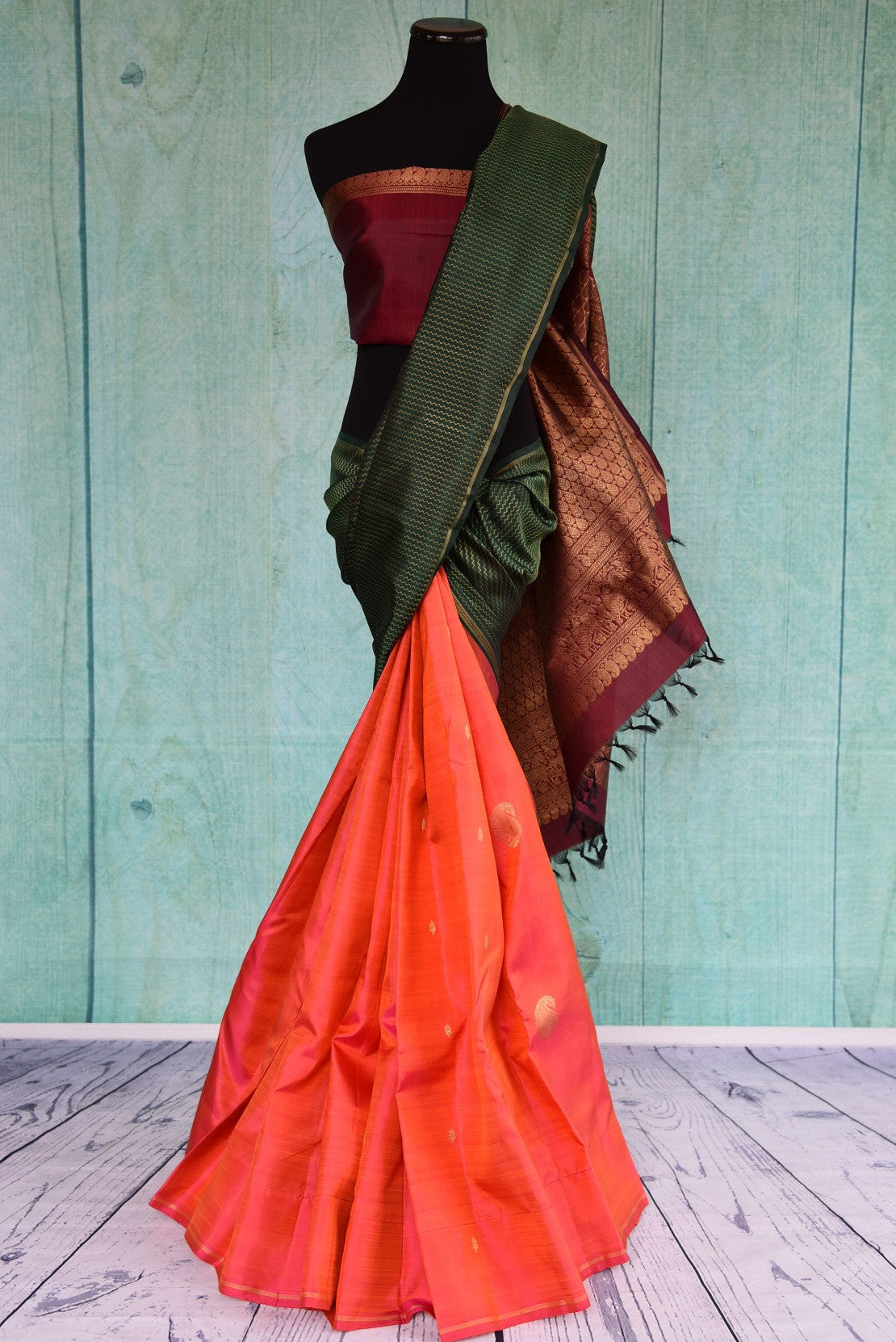 90D410 Orange and green kanjivaram saree with a maroon blouse and pallu. Buy this eye-catching, traditional saree online at our Indian wear store in USA - Pure Elegance.