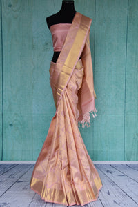 90D411 Baby pink kanjivaram saree with a dull golden pattern & border. This traditional ethnic saree, available at Pure Elegance, is a lovely pick for Indian weddings and functions.