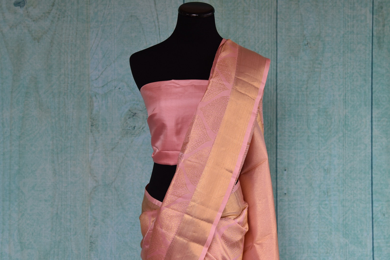 90D411 Soft pink kanjivaram saree with a dull golden pattern & border. This ethnic saree, available at Pure Elegance, is a lovely pick for Indian weddings and functions.