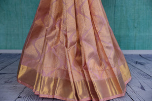 90D411 Baby pink kanjivaram saree with a dull golden pattern & border. This traditional ethnic saree, available at Pure Elegance, is an excellent pick for Indian weddings and functions.