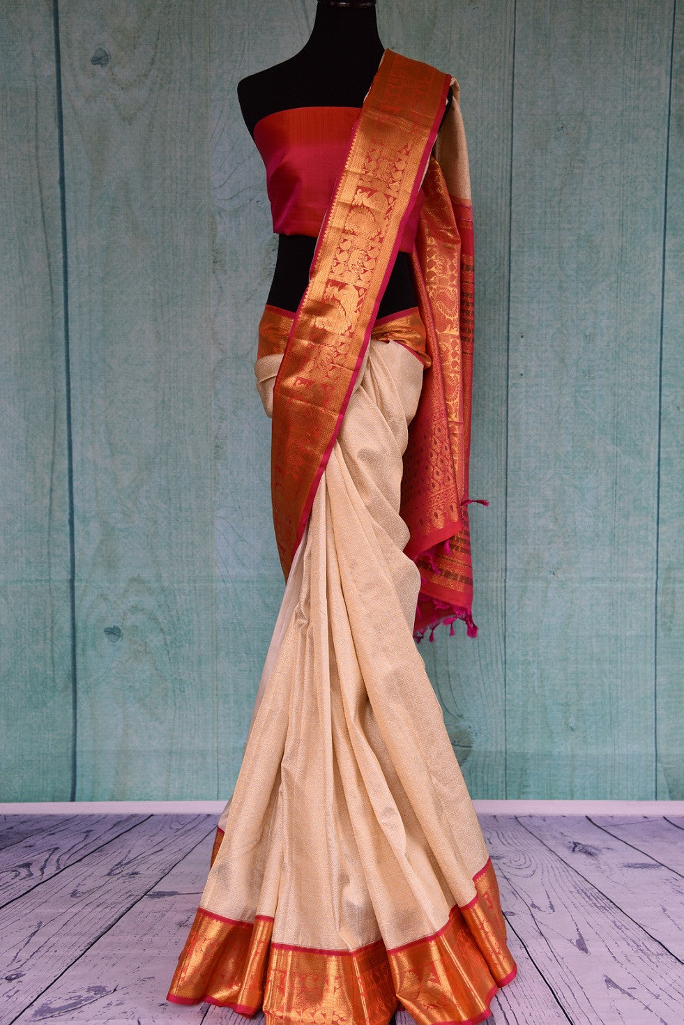 90D415 Get the traditional Indian look with this fabulous ethnic saree. The white, red & golden saree can be bought online at our Indian wear store in USA.