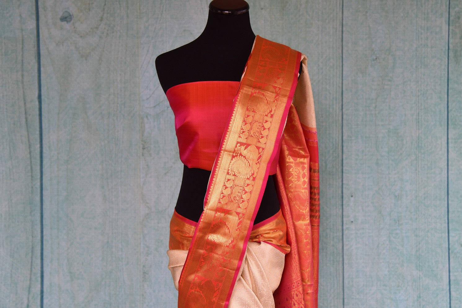 90D415 Get the traditional Indian look with this fabulous ethnic saree. The white, red & golden saree can be bought at our Indian wear store in USA.