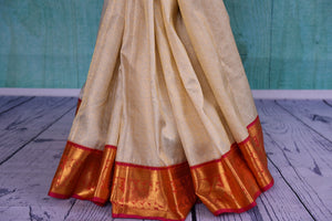 90D415 Get the traditional Indian look with this fabulous ethnic saree. The white, red & golden saree is available online at our Indian wear store in USA.