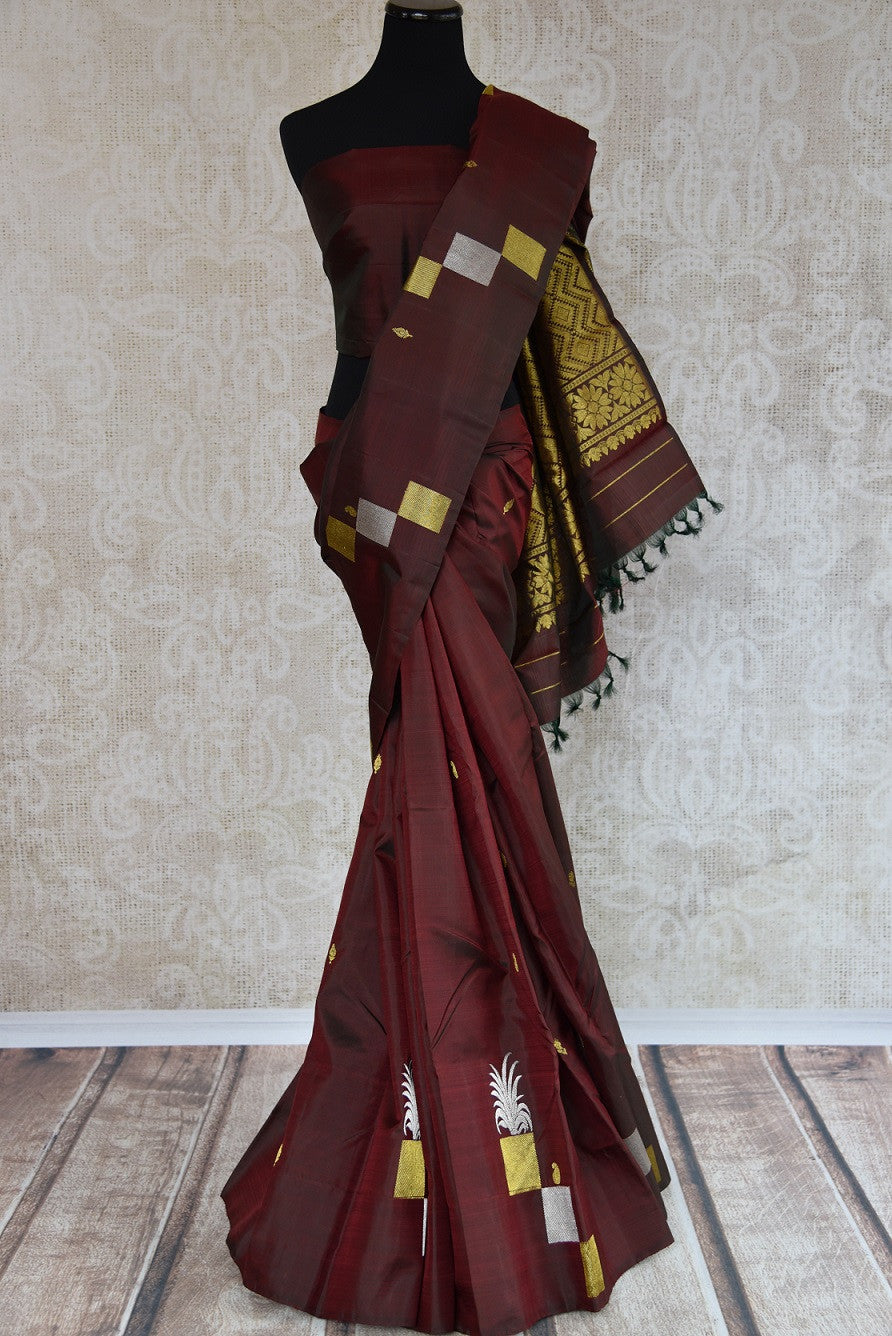 Shop this traditional Indian maroon kanjivaram saree from Pure Elegance online or from our store in USA. Perfect for any sangeet, engagement, wedding, puja or reception.  Top View.