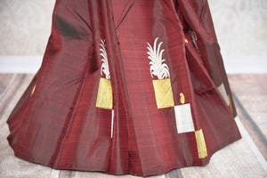Shop this traditional Indian maroon kanjivaram saree from Pure Elegance online or from our store in USA. Perfect for any sangeet, engagement, wedding, puja or reception. Maroon and Golden.