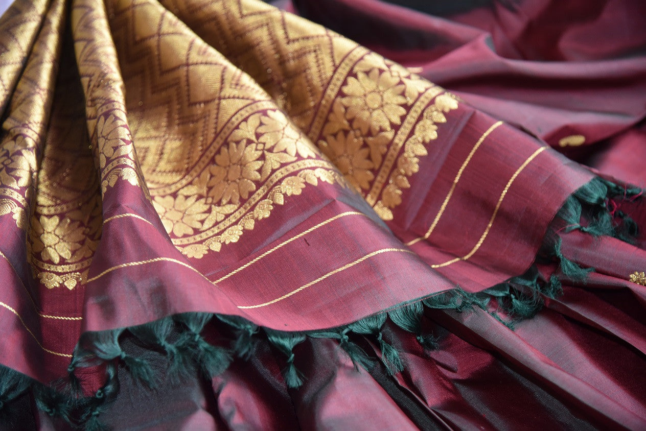 Shop this traditional Indian maroon kanjivaram saree from Pure Elegance online or from our store in USA. Perfect for any sangeet, engagement, wedding, puja or reception. Golden Pallu.