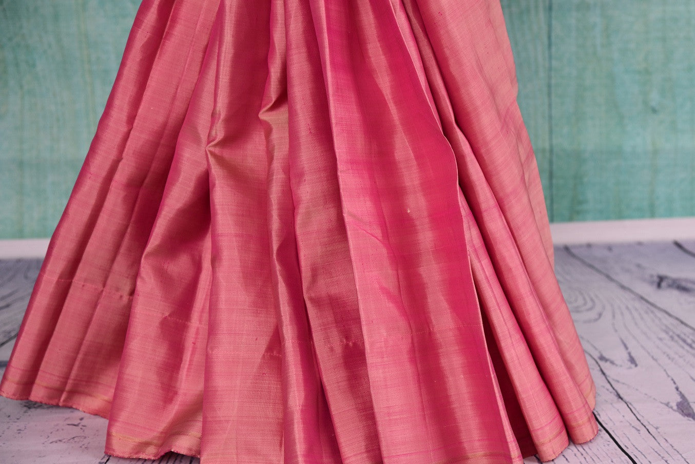 90D419 - Traditional pink kanjivaram saree that's a versatile Indian outfit. The plain saree is available at our ethnic clothing store - Pure Elegance, online and at our shop in Edison, USA.