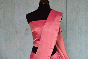 90D419 - Charming, simple pink kanjivaram saree that's a versatile Indian outfit. The plain sari can be bought at our ethnic clothing store - Pure Elegance, online and at our shop in Edison, USA.