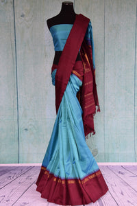 Buy this traditional Indian red and blue kanjivaram saree perfect for any wedding, reception, sangeet or engagement, puja and garba online or from our store in USA.  Front View.